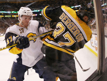 BOSTON - APRIL 19: Tyler Myers #57 of the Buffalo Sabres shoves Patrice Bergeron #37 of the Boston Bruins in Game Three of the Eastern Conference Quarterfinals during the 2010 NHL Stanley Cup Playoffs at TD Garden on April 19, 2010 in Boston, Massachusett