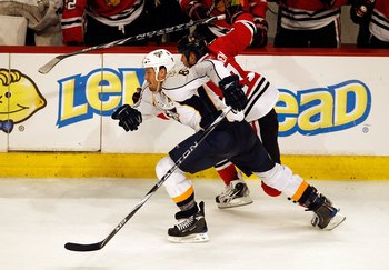 CHICAGO - APRIL 18: Shea Weber #6 of the Nashville Predators and John Madden #11 of the Chicago Blackhawks race up the ice in Game Two of the Western Conference Quarterfinals during the 2010 NHL Stanley Cup Playoffs at the United Center on April 18, 2010 