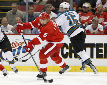 DETROIT - MAY 06: Nicklas Lidstrom #5 of the Detroit Red Wings passes away from Danny Heatley #15 of the San Jose Sharks during Game Four of the Western Conference Semifinals of the 2010 NHL Stanley Cup Playoffs on May 6, 2010 at Joe Louis Arena in Detroi
