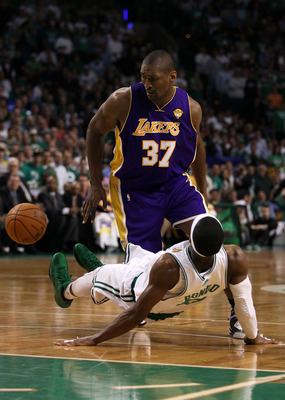 BOSTON - JUNE 08:  Ron Artest #37 of the Los Angeles Lakers drives against Rajon Rondo #9 of the Boston Celtics in the second half of Game Three of the 2010 NBA Finals on June 8, 2010 at TD Garden in Boston, Massachusetts. NOTE TO USER: User expressly ack