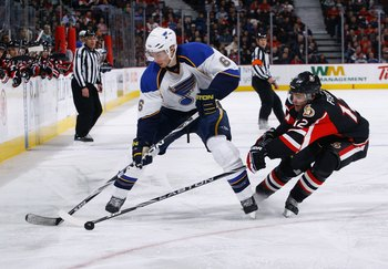OTTAWA, ON - JANUARY 21:  Erik Johnson #6 of the St. Louis Blues loses the puck to Mike Fisher #12 of the Ottawa Senators in a game at Scotiabank Place on January 21, 2010 in Ottawa, Canada.  (Photo by Phillip MacCallum/Getty Images)