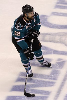 SAN JOSE, CA - MAY 18:  Dan Boyle #22 of the San Jose Sharks moves the puck while taking on the Chicago Blackhawks in Game Two of the Western Conference Finals during the 2010 NHL Stanley Cup Playoffs at HP Pavilion on May 18, 2010 in San Jose, California