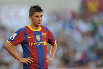 SANTANDER, SPAIN - AUGUST 29:  David Villa of Barcelona waits for play to resume during the La Liga match between Racing Santander and Barcelona at El Sardinero stadium on August 29, 2010 in Santander, Spain. (Photo by Denis Doyle/Getty Images)