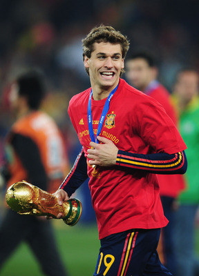 JOHANNESBURG, SOUTH AFRICA - JULY 11:  Fernando Llorente of Spain carries the World Cup trophy as the Spain team celebrate victory following the 2010 FIFA World Cup South Africa Final match between Netherlands and Spain at Soccer City Stadium on July 11,