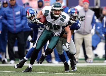 EAST RUTHERFORD, NJ - DECEMBER 07: Kevin Curtis #80 of the Philadelphia Eagles is tackled against the New York Giants at Giants Stadium on December 7, 2008 in East Rutherford, New Jersey.  (Photo by Nick Laham/Getty Images)
