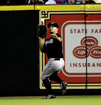 HOUSTON - APRIL 20:  Right fielder Cody Ross #12 of the Florida Marlins makes a catch on a fly ball of the bat of J.R. Towles of the Houston Astros in the fourth inning at Minute Maid Park on April 20, 2010 in Houston, Texas.  (Photo by Bob Levey/Getty Im