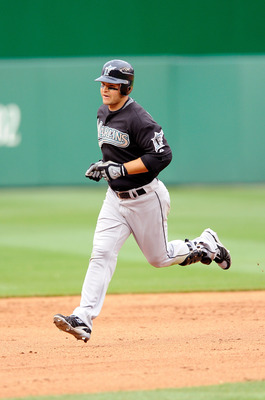 WASHINGTON - APRIL 19:  Cody Ross #12 of the Florida Marlins rounds the bases after hitting a home run in the eighth inning against the Washington Nationals at Nationals Park on April 19, 2009 in Washington, DC.  (Photo by Greg Fiume/Getty Images)