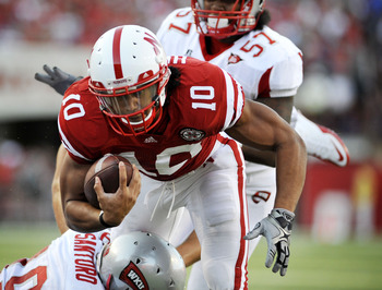LINCOLN, NE - SEPTEMBER 04:  Roy Helu Jr. #10 of the Nebraska Cornhuskers drives toward the endzone during first half action of their game at Memorial Stadium on September 4, 2010 in Lincoln, Nebraska.  Nebraska Defeated Western Kentucky 49-10. (Photo by