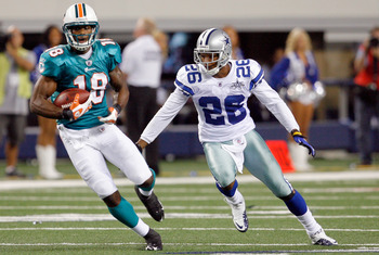 ARLINGTON, TX - SEPTEMBER 02: Wide receiver Roberto Wallace #18 of the Miami Dolphins carries the ball against cornerback Cletis Gordon #26 of the Dallas Cowboys at Cowboys Stadium on September 2, 2010 in Arlington, Texas. (Photo by Tom Pennington/Getty I