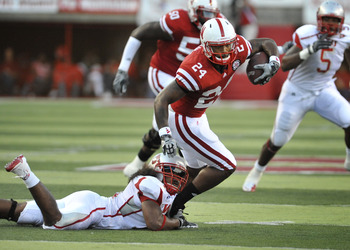 LINCOLN, NE - SEPTEMBER 04:  Orlando Misaalefua #31 of the Western Kentucky Hilltoppers tries to bring down Niles Paul #24 of the Nebraska Cornhuskers during first half action of their game at Memorial Stadium on September 4, 2010 in Lincoln, Nebraska.  N