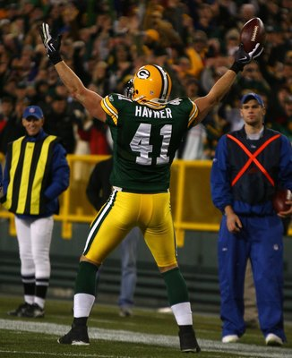 GREEN BAY, WI - NOVEMBER 15: Spencer Havner #41 of the Green Bay Packers celebrates a touchdown catch against the Dallas Cowboys at Lambeau Field on November 15, 2009 in Green Bay, Wisconsin. The Packers defeated the Cowboys 17-7. (Photo by Jonathan Danie