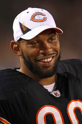 CHICAGO - AUGUST 21: Julius Peppers #90 of the Chicago Bears smiles on the sidelines during a preseason game against the Oakland Raiders at Soldier Field on August 21, 2010 in Chicago, Illinois. The Raiders defeated the Bears 32-17. (Photo by Jonathan Dan