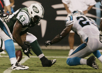CHARLOTTE, NC -  AUGUST 21:  Jason Davis #43 of the New York Jets fumbles the ball as Marcus Hudson #25 of the Carolina Panthers dives for the ball during their preseason game at Bank of America Stadium on August 21, 2010 in Charlotte, North Carolina. (Ph