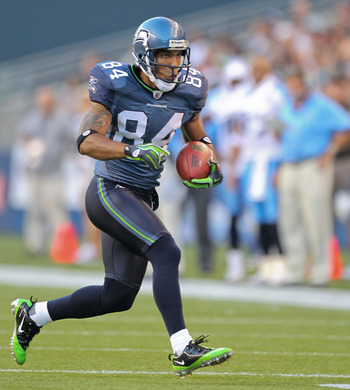 SEATTLE - AUGUST 14:  Wide receiver T.J. Houshmandzadeh #84 of the Seattle Seahawks rushes during the preseason game against  the Tennessee Titans at Qwest Field on August 14, 2010 in Seattle, Washington. (Photo by Otto Greule Jr/Getty Images)