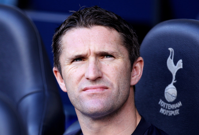 LONDON, ENGLAND - AUGUST 28:  Robbie Keane of Tottenham looks on from the bench during the Barclays Premier League match between Tottenham Hotspur and Wigan Athletic at White Hart Lane on August 28, 2010 in London, England.  (Photo by Phil Cole/Getty Imag