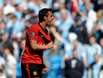 MANCHESTER, ENGLAND - APRIL 17:  Gary Neville of Manchester United celebrates at the end of  the Barclays Premier League match between Manchester City and Manchester United at the City of Manchester Stadium on April 17, 2010 in Manchester, England.  (Phot