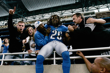 DETROIT, MI - SEPTEMBER 27: Defensive back Louis Delmas #26 of the Detroit Lions celebrates with fans after the victory against the Washington Redsklns at Ford Field on September 27, 2009 in Detroit, Michigan. The Lions defeated the Redskins 19-14. (Photo