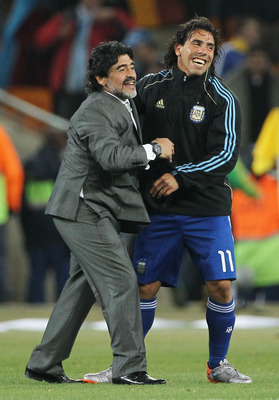 JOHANNESBURG, SOUTH AFRICA - JUNE 27:  Diego Maradona head coach of Argentina celebrates victory with Carlos Tevez following the 2010 FIFA World Cup South Africa Round of Sixteen match between Argentina and Mexico at Soccer City Stadium on June 27, 2010 i
