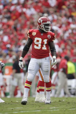 KANSAS CITY, MO - SEPTEMBER 20:  Tamba Hali #91 of the Kansas City Chiefs looks on during the game against the Oakland Raiders at Arrowhead Stadium on September 20, 2009 in Kansas City, Missouri. (Photo by Jamie Squire/Getty Images)