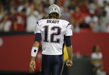 ATLANTA - AUGUST 19:  Quarterback Tom Brady #12 of the New England Patriots walks to the bench during the preseason game against the Atlanta Falcons at the Georgia Dome on August 19, 2010 in Atlanta, Georgia.  The Patriots beat the Falcons 28-10.  (Photo
