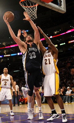 LOS ANGELES, CA - APRIL 12: Marc Gasol #33 of the Memphis Grizzlies goes up for a shot over Josh Powell #21 of the Los Angeles Lakers on April 12, 2009 at Staples Center in Los Angeles, California. The Lakers won 92-75. NOTE TO USER: User expressly acknow