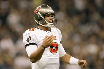 NEW ORLEANS - DECEMBER 27:  Quarterback Josh Freeman #5 of the Tampa Bay Buccaneers looks down the field during the game against the New Orleans Saints at the Louisiana Superdome on December 27, 2009 in New Orleans, Louisiana. (Photo by Jamie Squire/Getty