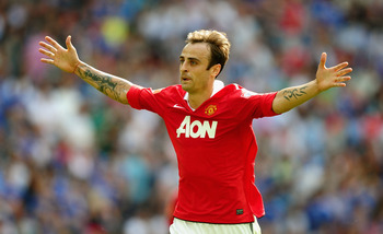LONDON, ENGLAND - AUGUST 08:  Dimitar Berbatov of Manchester United celebrates as he scores their third goal during the FA Community Shield match between Chelsea and Manchester United at Wembley Stadium on August 8, 2010 in London, England.  (Photo by Lau