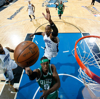 Dwight Howard, rushing for the swat on Rajon Rondo.