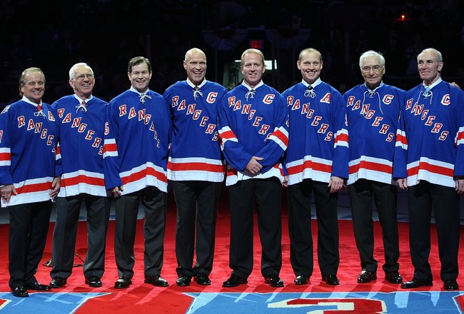 NEW YORK - FEBRUARY 22:  Former New York Ranger players  whose numbers have been retired join with Andy Bathgate and Harry Howell as they are given the same honor prior to the game between the Toronto Maple Leafs and the New York Rangers on February 22, 2