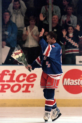 NEW YORK, NY - APRIL 18:  Wayne Gretzky #99 of the New York Rangers waves to the crowd as he skates on the ice during retirement ceremonies after his final career game against the Pittsburgh Penguins at the Madison Square Garden on April 18, 1999 in New Y