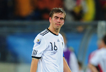 DURBAN, SOUTH AFRICA - JULY 07:  Dejected Philipp Lahm of Germany after being knocked out of the tournament during the 2010 FIFA World Cup South Africa Semi Final match between Germany and Spain at Durban Stadium on July 7, 2010 in Durban, South Africa.