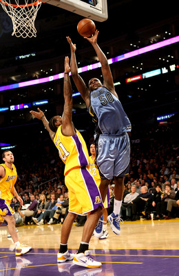 LOS ANGELES, CA - NOVEMBER 06:  Zach Randolph #50 of the Memphis Grizzlies shoots over Josh Powell #21 of the Los Angeles Lakers on November 6, 2009 at Staples Center in Los Angeles, California. The Lakers won 114-98.  NOTE TO USER: User expressly acknowl