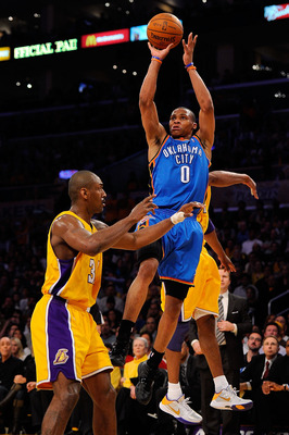 LOS ANGELES, CA - APRIL 27:  Russell Westbrook #0 of the Oklahoma City Thunder shoots over Ron Artest #37 of the Los Angeles Lakers in the first half during Game Two of the Western Conference Quarterfinals of the 2010 NBA Playoffs at Staples Center on Apr