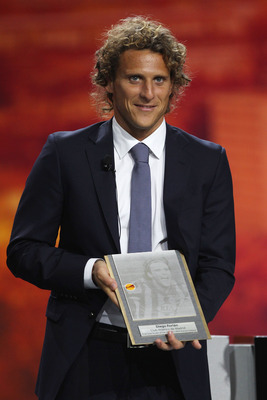 MONACO - AUGUST 27:  Diego Forlan of Atletico Madrid and Uruguay receives a plaque for scoring the winning goal in last seasons Europa League final during the UEFA Europa League Group Stage Draw at the Grimaldi Forum on August 27, 2010 in Monaco, Monaco.