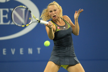 NEW YORK - AUGUST 31:  Caroline Wozniacki of Denmark returns a shot against Chelsey Gullickson of the United States during her first round women's singles match on day two of the 2010 U.S. Open at the USTA Billie Jean King National Tennis Center on August