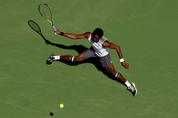 NEW YORK - SEPTEMBER 04:  Gael Monfils of France returns a shot against Janko Tipsarevic of Serbia during the men's singles match on day six of the 2010 U.S. Open at the USTA Billie Jean King National Tennis Center on September 4, 2010 in the Flushing nei