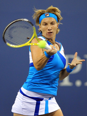 NEW YORK - SEPTEMBER 04:  Svetlana Kuznetsova of Russia returns a shot against Maria Kirilenko of Russia during her women's singles match on day six of the 2010 U.S. Open at the USTA Billie Jean King National Tennis Center on September 4, 2010 in the Flus