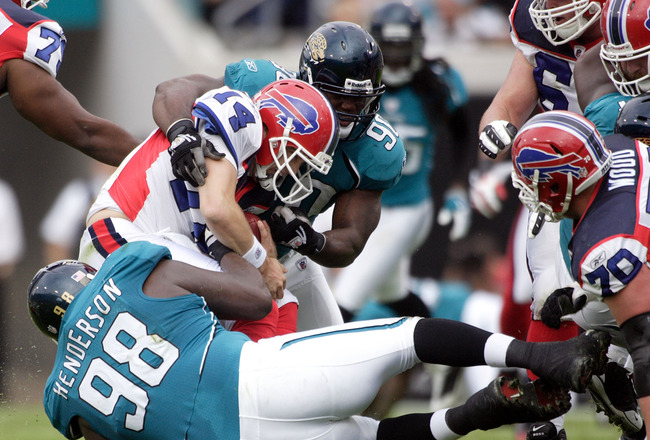 JACKSONVILLE, FL - NOVEMBER 22:  Quarterback Trent Edwards #5 of the Buffalo Bills passes is sacked by defensive end John Henderson #98 of the Jacksonville Jaguars at Jacksonville Municipal Stadium on November 22, 2009 in Jacksonville, Florida.  (Photo by