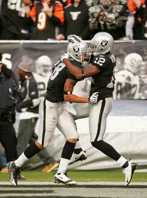 OAKLAND, CA - NOVEMBER 22:  Louis Murphy #18 of the Oakland Raiders is congratulated by Darrius Heyward-Bey #12 after Murphy scored the tying touchdown against the Cincinnati Bengals at Oakland-Alameda County Coliseum on November 22, 2009 in Oakland, Cali