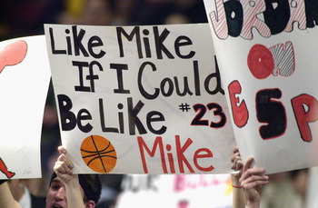 CHICAGO - JANUARY 24:  Chicago Bulls fans hold signs honoring Michael Jordan #23 of the Washington Wizards during Jordan's last appearance against his old team at the United Center on January 24, 2003 in Chicago, Illinois.  The Bulls won 104-97.  NOTE TO