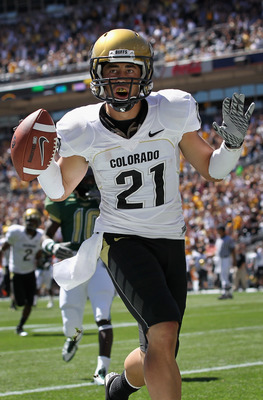DENVER - SEPTEMBER 04:  Wide receiver Scotty McKnight #21 of the Colorado Buffaloes celebrates 27 yard touchdown reception to give the Buffs a 14-0 lead over the Colorado State Rams in the second quarter of the Rocky Mountain Showdown at INVESCO Field at