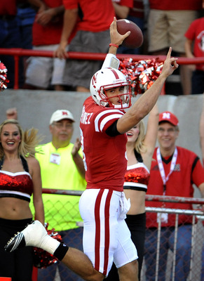 LINCOLN, NE - SEPTEMBER 04:  Taylor Matinez #3 of the Nebraska Cornhuskers scores his first touchdown as a Cornhusker during the first half against the Western Kentucky Hilltoppers at Memorial Stadium on September 4, 2010 in Lincoln, Nebraska.  (Photo by