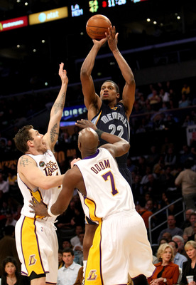 LOS ANGELES - MARCH 3:  Rudy Gay #22 of the Memphis Grizzlies shoots over Luke Walton #4 and lamar Odom #7 of the Los Angeles Lakers on March 3, 2009 at Staples Center in Los Angeles, California.  The Lakers won 99-89.   NOTE TO USER: User expressly ackno