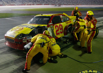 HAMPTON, GA - SEPTEMBER 05:  Kevin Harvick, driver of the #29 Shell/Pennzoil Chevrolet, pits as his crew repairs damage to the car during the NASCAR Sprint Cup Series Emory Healthcare 500 at Atlanta Motor Speedway on September 5, 2010 in Hampton, Georgia.