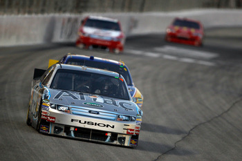 HAMPTON, GA - SEPTEMBER 05:  Carl Edwards, driver of the #99 Aflac Ford, leads a group of cars during the NASCAR Sprint Cup Series Emory Healthcare 500 at Atlanta Motor Speedway on September 5, 2010 in Hampton, Georgia.  (Photo by Todd Warshaw/Getty Image