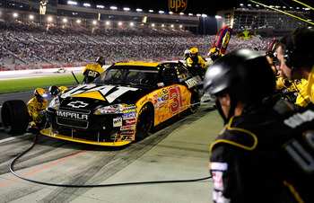 HAMPTON, GA - SEPTEMBER 05: Jeff Burton, driver of the #31 Caterpillar Chevrolet, pits during the NASCAR Sprint Cup Series Emory Healthcare 500 at Atlanta Motor Speedway on September 5, 2010 in Hampton, Georgia.  (Photo by Rusty Jarrett/Getty Images for N