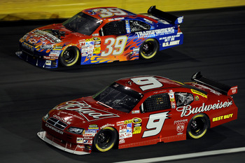 CONCORD, NC - OCTOBER 17:  Ryan Newman, driver of the #39 Transformers Chevrolet, races Kasey Kahne, driver of the #9 Budweiser Dodge, during the NASCAR Sprint Cup Series NASCAR Banking 500 at Lowe's Motor Speedway on October 17, 2009 in Concord, North Ca