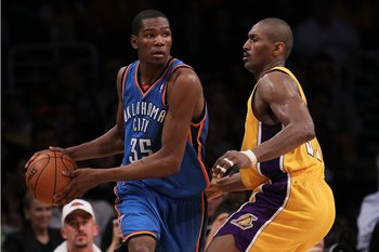 LOS ANGELES, CA - APRIL 27:  Kevin Durant #35 of the Oklahoma City Thunder looks to pass the ball as he is covered by Ron Artest #37 of the Los Angeles Lakers during Game Five of the Western Conference Quarterfinals of the 2010 NBA Playoffs at Staples Cen