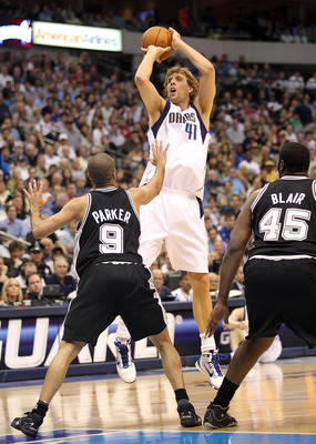 DALLAS - APRIL 21:  Forward Dirk Nowitzki #41 of the Dallas Mavericks takes a shot against Tony Parker #9 and DeJuan Blair #45 of the San Antonio Spurs in Game Two of the Western Conference Quarterfinals during the 2010 NBA Playoffs at American Airlines C