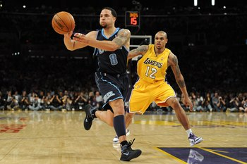 LOS ANGELES, CA - MAY 04:  Deron Williams #8 of the Utah Jazz passes the ball alongside Shannon Brown #12 of the Los Angeles Lakers during Game Two of the Western Conference Semifinals of the 2010 NBA Playoffs at Staples Center on May 4, 2010 in Los Angel